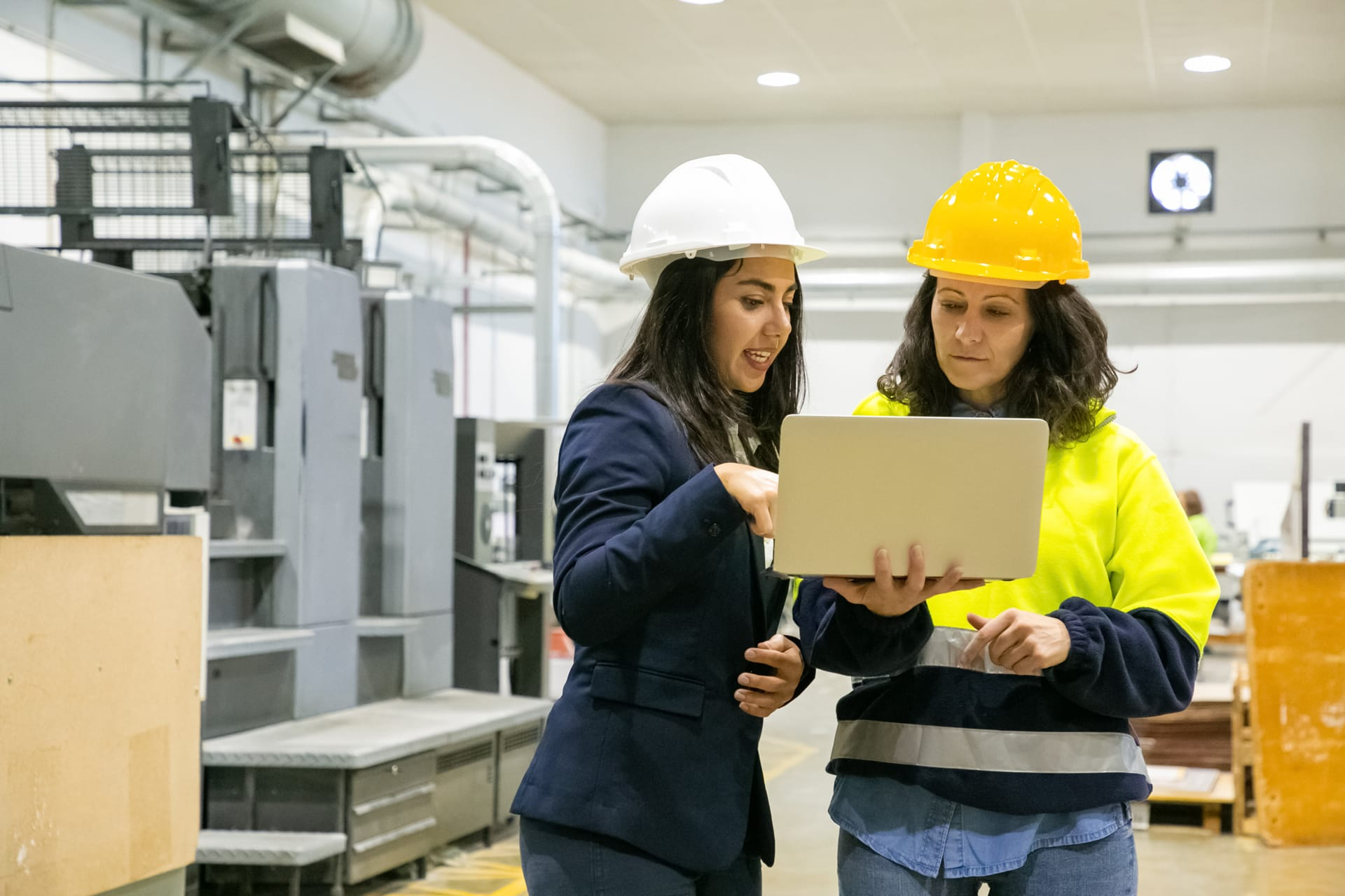 Women Discussing Manufacturing Plans